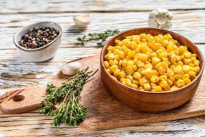 sweet canned corn in a bowl - Салат из крабовых палочек с ананасами и сыром