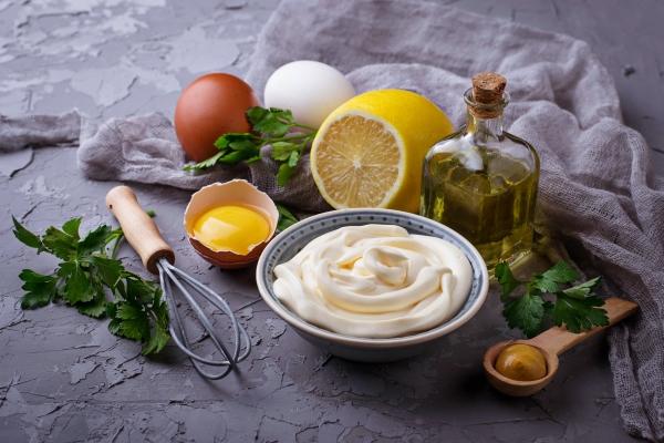 homemade mayonnaise sauce and olive oil eggs mustard lemon selective focus - Архангельский салат из трески